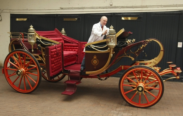 Carriage restorer Dave Evans cleans the 1902 State Landau coach at the Royal Mews in London. Weather permitting, the coach will be used to carry Britain's Prince William and Kate Middleton on their wedding day, April 29.